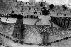 Micha Bar Am  Jerusalem.The Wailing Wall, on the right is the section 'reserved' for Women. 1985.
