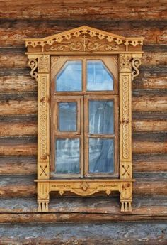 Carving decorated window in country wooden house, Russia
