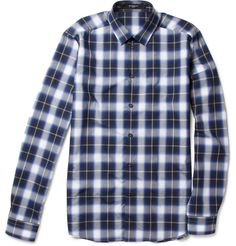 """Even designer Ricardo Tisci for Givenchy couldn't resist using some form of blessings ti inspire the Spring/Summer 2012 Season    """"Givenchy menswear designer Ricardo Tisci firmly rooted his SS12 collection in gothic Catholic iconography, and this plaid shirt with a crucifix back panel subtly incorporates the trend. Let the rich pattern pack a punch and team it with laid-back black separates""""    Courtesy: Mr. Porter"""