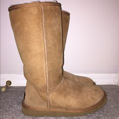 Classic tall chestnut Uggs Classic tall chestnut Uggs in size 5. Worn a handful of times, sheepskin is in great condition with one or two very faint water marks as seen in pictures. UGG Shoes