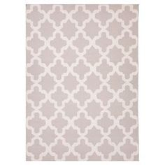 Handmade wool rug with a quatrefoil trellis motif.  Product: RugConstruction Material: 100% WoolColor: Gray and whiteFeatures:  ReversibleDurableEasy care  Note: Please be aware that actual colors may vary from those shown on your screen. Accent rugs may also not show the entire pattern that the corresponding area rugs have.Cleaning and Care: Vacuum regularly. If spills occur blot immediately