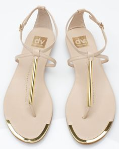 Archer In Nude Dolce Vita A fancier version of the thong sandal from Dolce. - Archer In Nude Dolce Vita A fancier version of the thong sandal from Dolce Vita, featuring buckle ankle strap, criss-cross detail, and front gold acce. Cute Sandals, Cute Shoes, Me Too Shoes, Shoes Sandals, Gold Sandals, Pretty Sandals, Simple Sandals, Metallic Sandals, Strappy Sandals