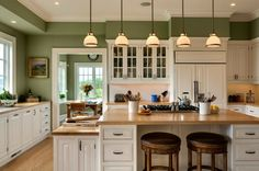 But Kris can't see green :( Kitchen Paint Colors: 10 Handsome Hues for Hardworking Spaces - Moss Green Walls, White Cabinetry & Butcher Block Counters Green Kitchen Walls, Paint For Kitchen Walls, Kitchen Paint Colors, White Kitchen Cabinets, Oak Cabinets, Kitchen White, Cream Cabinets, White Cupboards, Kitchen Color Schemes