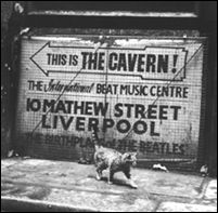 A sign on a Liverpool, England street points to the Cavern Club, where The Beatles played over 230 performances in the early 1960s.