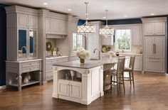 Like how fan is enclosed. Maple Kitchen in Pebble Grey and Canvas - KraftMaid