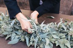 eucalyptus table runner DIY  For more wedding inspiration check out our blog www.creativeweddingco.com