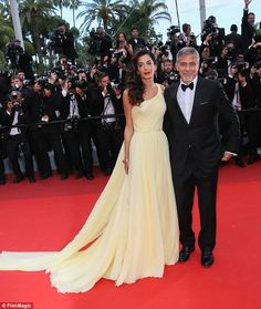 Red carpet romance: George and Amal - pictured in May 2016 - met through mutual friends at a charity fundraising event in September 2013 and tied the knot one year later in September 2014