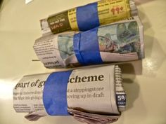Firestarter:  old newspapers/dryer lint/small sticks or pine needles or hay/roll, close w/masking tape and dip into or drizzle w/wax.  Recycled and burns great - no freaky smells.