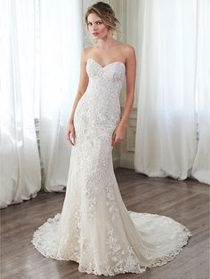 Maggie Sottero - ARLYN, DISCONTINUED - This lace slim A-line gown channels timeless elegance with its classic sweetheart neckline, cascading floral lace appliqués, and lace-trimmed hemline. Finished with corset closure or button over zipper closure with inner corset.