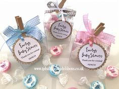 Personalised Baby Shower Favour boxes. How cute are these baby shower gifts for your guests? Pre filled with scrumptious strawberry flavour rock sweets in pink or blue, decorated with a gorgeous gingham ribbon bow and keepsake tag.