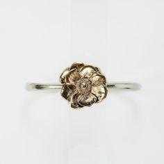Bracciale rigido in argento con fiore smaltato in ottone