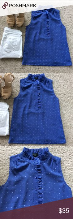 """J. Crew Sleeveless Blouse J. Crew Sleeveless Blouse. Gorgeous periwinkle color with little white polka dots. Buttons 1/2 way up with ruffle detailing with raw edging. Lined. Laying flat approx 25"""" shoulder to hem, approx 18.5"""" pit to pit. 100% polyester. Size 4. NWT (and extra button). #1021 J. Crew Tops Blouses"""