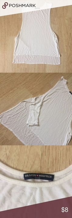 Brandy Melville White Muscle High Low Shirt From Brandy Melville one size white muscle tank top in good condition high low look has open slits on the sides very soft and comfortable great to wear with anything bundle if interested    Tags Hollister American Eagle American Apparel Misguided Brandy Melville Forever 21 H&M Free People Asos Urban Outfitters Adidas Topshop Zara Tommy Hilfiger Guess Calvin Klein revolve lulus Tobi Levis Pink Victoria Secret Brandy Melville Tops Muscle Tees