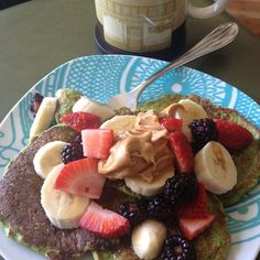 Green protein pancakes with peanut butter and fruit, so good! Blend spinach with your favorite pancake recipe (I use #coachsoats egg whites ...