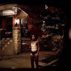 TIME magazines Karl Vick and photographer Natalie Keyssar followed the police officers of West Philadelphias District 19 to find out what it means to be a cop in America today.  In this photo by @nataliekeyssar a young woman watches from a street corner in West Philadelphia as police drive by. July 28 2015. Philadelphia Pa.  See more photos on lightbox.time.com.  #police #cops #Philadelphia # # by time