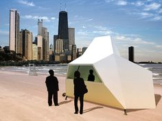 The kiosk's function transforms through rotation: open pavilion, summer kiosk, a winter chapel; Tinted skylights cast a warm glow during the day and internal lighting combined with colored windows create a waterfront beacon at night. — Light House by Knowhow Shop | Los Angeles, USA — Chicago Architecture Biennial Lakefront Kiosk Competition Los Angeles Shopping, Skylights, Light House, Kiosk, Small Living, Pavilion, Night Light, Pop Up, Competition