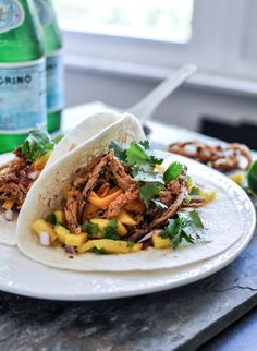 Crockpot BBQ Beer Pulled Pork Tacos with Crispy Onion Straws and Mango Salsa | howsweeteats.com