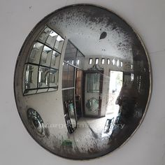 Smoked glass mirror is glass held in the smoke of a candle flame (or other inefficiently burning hydrocarbon) such that one surface of the sheet. Convex Mirror, Round Wall Mirror, Mirror Art, Round Mirrors, Mirror Above Fireplace, Distressed Mirror, Vintage Mirrors, Mirrored Furniture, Gold Wash