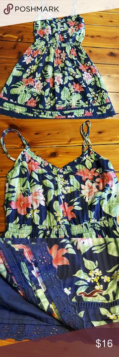 Hollister dress Navy blue with pink, white, yellow and green floral print . 5 buttons at top, adjustable straps. This dress has a cotton skirt liner built in. Floral Tops, Floral Prints, Hollister Dresses, Pink White, Yellow, Cotton Skirt, Navy Blue Dresses, Fashion Design, Fashion Tips