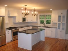 Best Remodel White Kitchen Cabinet Design Ideas With Cool Black Granite Countertops Using Eased Edge Profile And Modern Island Under Twin Branched Chandeliers With Cheap Kitchen Remodel  Plus Galley Kitchen Designs , The Best Remodel Kitchen Cabinets Ideas With New Layout Home Design: Furniture, Interior, Kitchen