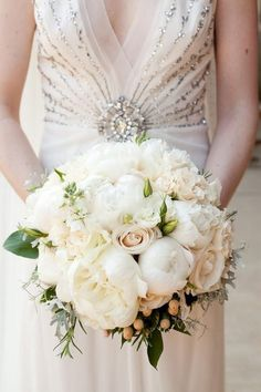 Weddbook ♥ Classic white roses and peonies wedding bridal bouquet with a sparkling dress. Elegant bride and bridesmaid bouquet ideas. Wedding bouquet photography by Robin Lin. Floral Design by Tre Bella Flowers. classic sparkle white summer spring bouquet flower