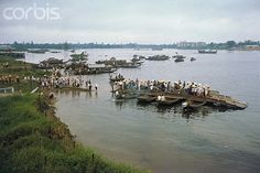 https://flic.kr/p/6EXU9T | U1589813 | 14 Apr 1968, Hue, South Vietnam --- A makeshift ferry- sampans lashed together- carries residents across the perfume river which bisects the city. --- Image by © Bettmann/CORBIS