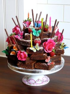 Birthday guy or gal doesn't like cake? How about a stacked brownie cake with random candles and flowers sticking out?