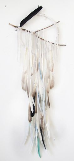 LOVE! DIY feather dream catcher. I must make this!