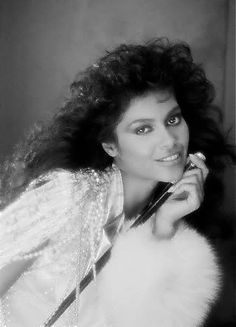 """Denise Katrina Matthews (4 January 1959—15 February 2016), better known as Vanity, was a Canadian singer, songwriter, dancer, actress and model, who turned away from her music and acting career to concentrate on evangelism. Her career lasted from the early–1980s until the mid–1990s. She was the lead singer of the female trio Vanity 6, from 1981 until it disbanded in 1983. They are known for their 1982 R&B/funk hit """"Nasty Girl"""". Beautiful Black Women, Beautiful People, Stunning Women, Simply Beautiful, Denise Matthews, Vanity 6, Prince Rogers Nelson, Purple Reign, The Victim"""