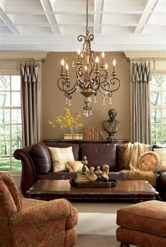 Love the ceiling detail and also the use of the leather sofa with the rust colored chairs. Gives warmth to the room.