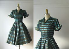 vintage 1950s black and turquoise striped party dress made from gorgeous heavyweight silk blend with metallic gold squiggles through out and a big full skirt