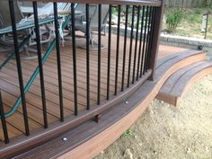Double pictured Trex curved deck.  Built in deck lights add a great accent to the Transcends curved railing.