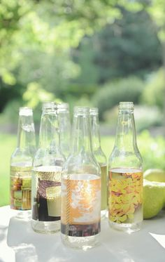 Party tip: Put photos in empty bottles. #easy #party