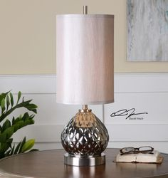Uttermost Valpelline Lamp. Subtly translucent, silver mercury glass accented with brushed nickel plated details. The round hardback drum shade is a silken silver gray linen fabric.