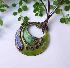 Lifespiral Cloisonne Enamel pendant in green and purple, garden vitreous enamel necklace : Lifespiral Cloisonne Enamel pndant in green and purple by NiadaJewellery on Etsy Ceramic Pendant, Ceramic Jewelry, Ceramic Beads, Clay Beads, Metal Jewelry, Enamel Jewelry, Jewellery, Polymer Clay Necklace, Polymer Clay Pendant