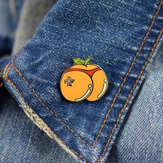 "For all you booty (and ATL) lovers out there. Wear our completely adorable lapel pin alone, or with a few others and if you're not one to pin it on your jacket how about your bag? • 1"" Hard Enamel Pin"