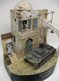 """Welcome to Africa - March 1941 Tripoli Libya"" 1/35 scale. By Roy Schurgers. ""Interaction between all the elements is the key 2 a good diorama. "" German PzKpfw II tank. #diorama #WW2 http://diodump.wix.com/master-model-maker#!Welome%20to%20Africa/zoom/c4fi/image8sh"