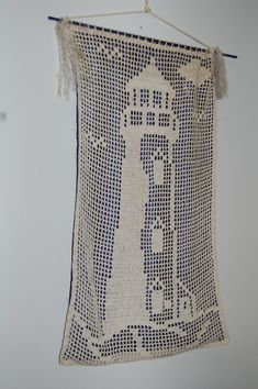filet crochet lighthouse / Just happened to find this lighthouse pattern in a magazine.  Crocheted it years ago.  Love the way it hangs.  Jaye