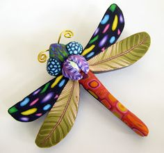dragonfly polymer clay. Love the feather cane for the wings.