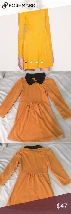 ASOS mustard dress with collar Super cute mustard colored dress with a black collar! In amazing condition!! Material: 68% polyester, 28% viscose. Asos Dresses Mini