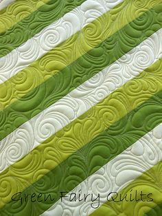 Free Motion Feather Swirl-----I'm impressed with this because the fabric design is so basic, but it really comes to life with the machine quilting stitch.