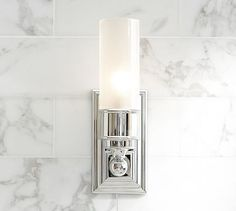 "Sussex Tube Sconce #potterybarn$129  4"" wide x 4.5"" deep x 13"" high   Crafted of forged and stamped brass.   Thick frosted-glass shade.   Hardwire; professional installation recommended.   UL-listed.   Catalog / Internet Only."