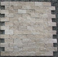 Split Face 1x2 Classic Beige Travertine For Kitchen Bathroom backsplash & Exterior Use: Splitface Tumble Classic Travertine meshed on 12x12 Sheet Tiles for Kitchen Backsplash, Shower Walls. Exterior Use recommended. Each tile is one square foot. We also Carry Pencil and Chairrail listello Moldings. Travertine has inherent unfilled holes. We also carry onyx mosaics in Gold, Red and Green Onyx in color. Purchase directly from the manufacturer and save. Give us a call and talk to our de...