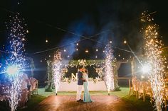 Gorgeous fireworks display backdrop with a romantic kiss and slow dance // Yoska and Nariza capped off their week-long celebrations with a bang with a sunset ceremony and dinner reception held at Phalosa Villa, Seminyak, Bali, shot by Haniff Hazim of Wedlocx and planned by Bali Berdua. The couple hosted an intimate, travel-themed destination wedding for their closest friends and family, complete with an encore performance of the flash mob number they performed during their reception
