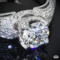 """WOW! Vintage in style, the """"Sarah's Surprise"""" Diamond Engagement Ring recalls the beauty of times past. Sparkling with 50 gorgeous A CUT ABOVE® Hearts and Arrows Diamond Melee (0.33ctw; F/G VS), this ring is sure to steal her heart."""