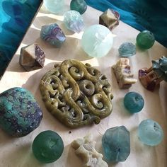 My surprise package from @capitalcitybeads came today. The anticipation was especially strong as I did not know of the contents! I put my trust in the hands of a skilled curator of beauty.WOW did the bead shop owner Christina hit the nail on the head of what I LOVE! Chinese Dragon carved Jade & Soap stone earthy Turquoise dreamy Fluorite crystals & mermaid treasure African sea glass. I'm in heaven & so gratefulCan't wait to create my heART out! Check out @capitalcitybeads page & website for…