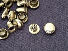 Vienna La Rouge's silver nailhead rivet studs for the detail on the 'skirts' of the blue leather battledress.