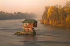 A TINY RIVER HOUSE IN SERBIA Photograph by Irene Becker for National Geographic My friend Dan G. emailed me this wonderful photograph by Irene Becker that shows a tiny house in the middle of the Drina River near the town of Bajina Basta, Serbia. Solar Panel Cost, River House, Little Houses, Go Green, Renewable Energy, Far Away, Tiny House, The Good Place, Building A House