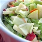 Apple Cole Slaw Recipe     3 cups chopped cabbage  1 unpeeled red apple, cored and chopped  1 unpeeled Granny Smith apple, cored and chopped  1 carrot, grated  1/2 cup finely chopped red bell pepper  2 green onions, finely chopped  1/3 cup mayonnaise  1/3 cup brown sugar  1 tablespoon lemon juice, or to taste