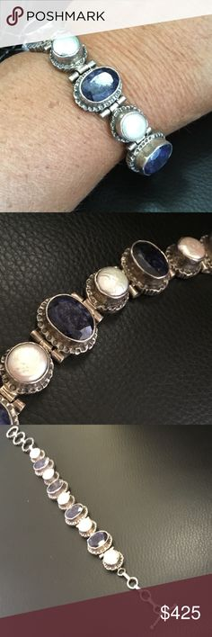 925 Sterling silver sapphire mother pearl bracelet 925 Sterling silver sapphire mother of pearl bracelet. Features five large oval bezel set natural sapphire in between five natural mother of pearl in a vintage and incredible setting design. Can be attached with the toggle on links at multiple levels to accommodate almost any size rest as it measures nearly 9 inches in length and can be toggled to as little as 7 inches With exception to the natural sapphire surface inclusions 1 small chip on…